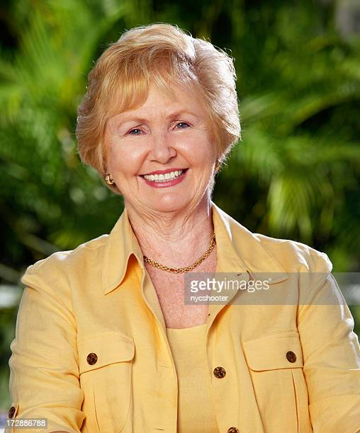 senior adult woman portrait - older redhead stock pictures, royalty-free photos & images