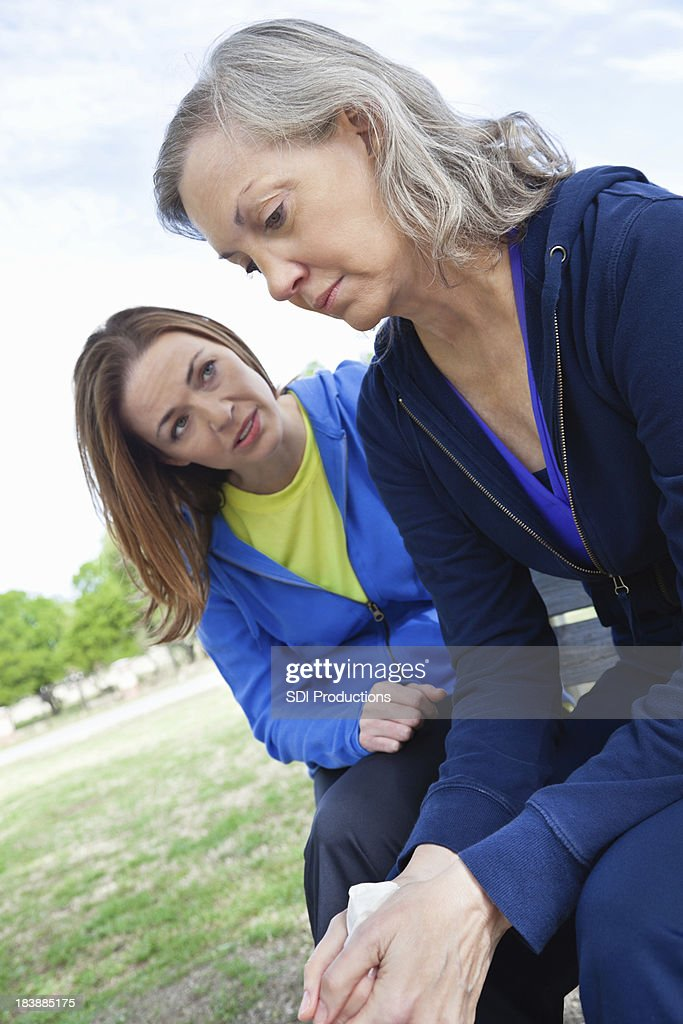 Senior Adult Woman Receiving Encouragement From Supportive Friend : Stock Photo