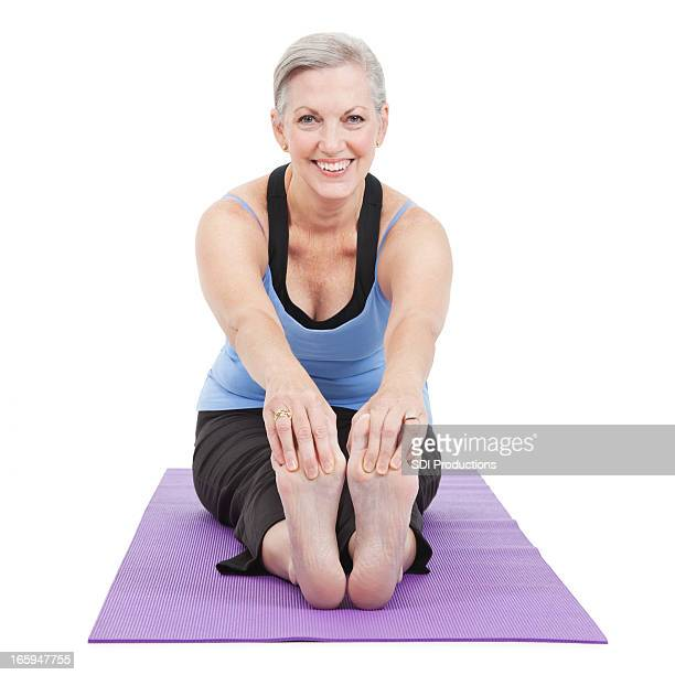senior adult woman stretching forward on yoga mat - old lady feet stock pictures, royalty-free photos & images
