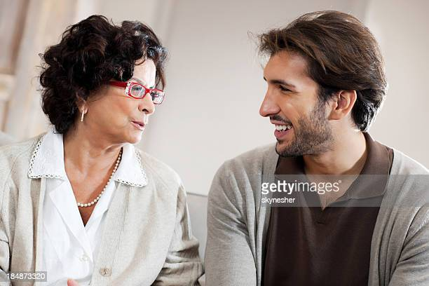 Senior adult woman talking to her son.