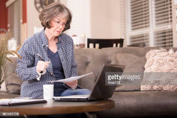 Senior adult woman works from home.