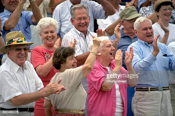 Senior adults applauding