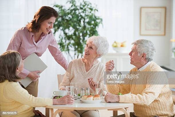 Senior adults eating dinner