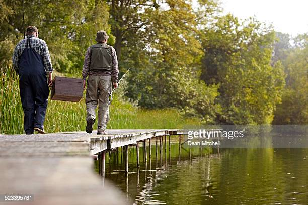 senior adults going for fishing at the lake - fishing tackle stock pictures, royalty-free photos & images