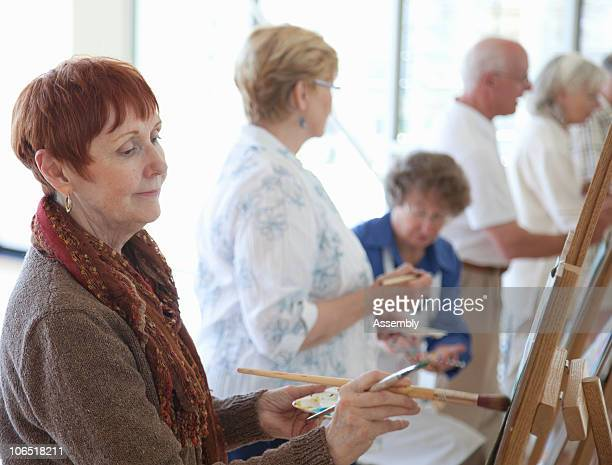 Senior adults in painting class