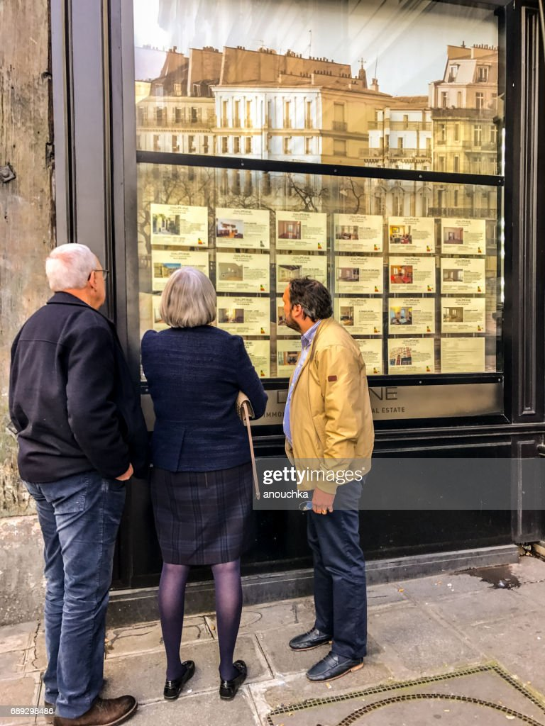 Senior adults looking at Real Estate for rent and sale in Paris, France : Stock Photo