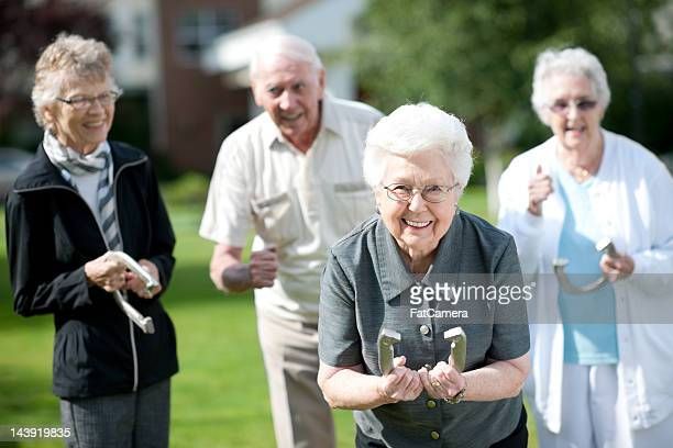 senior adults - horseshoe stock pictures, royalty-free photos & images