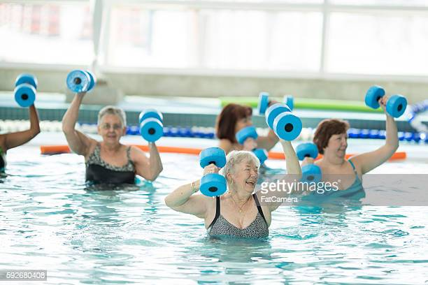 senior adults taking a water aerobics class at the pool - leisure facilities stock pictures, royalty-free photos & images