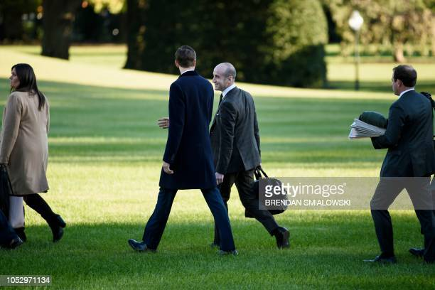 Senior Advisor Jared Kushner advisor Stephen Miller and others follow US President Donald Trump to Marine One on the South Lawn of the White House...