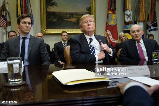 TOPSHOT Senior Advisor Jared Kushner and Secretary of Homeland Security John Kelly listen while US President Donald Trump puts his papers away at the...
