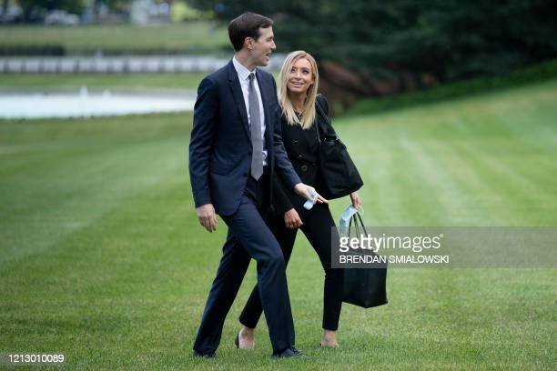 Senior Advisor Jared Kushner and White House Press Secretary Kayleigh McEnany walk to the White House on May 14 in Washington DC after returning from...
