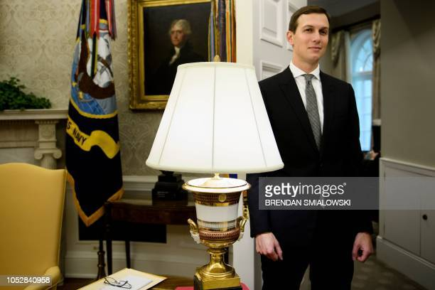 Senior Advisor Jared Kushner listens while his fatherinlaw US President Donald Trump speaks during a bill signing for S3021 in the Oval Office of the...