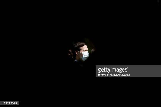 Senior Advisor Jared Kushner looks on as US President Donald Trump speaks during a news conference on the novel coronavirus, COVID-19, in the Rose...