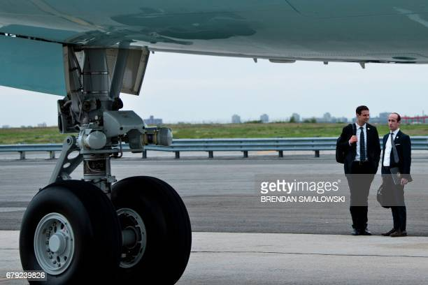Senior advisor Stephen Miller waits for US President Donald Trump under Air Force One while arriving at John F Kennedy International Airport May 4...