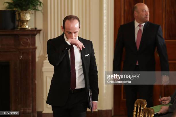 Senior Advisor to the President for Policy Stephen Miller and Director of the National Economic Council Gary Cohn arrive for a news conference with...