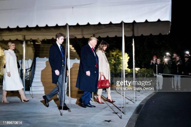 Senior Advisor to the President Ivanka Trump Barron Trump US President Donald Trump and US first lady Melania Trump walk to Marine One on the South...