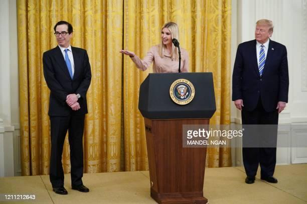 Senior Advisor to the President Ivanka Trump with US President Donald Trump and US Secretary of the Treasury Steve Mnuchin speaks in the East Room of...