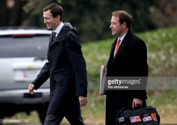 Senior advisor to US President Donald Trump Jared Kushner and Trump's personal aide Jordan Karem depart the White House with Trump on November 26...