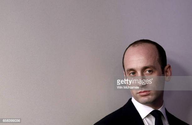 Senior advisor to US President Donald Trump Stephen Miller watches as US Attorney General Jeff Sessions delivers remarks during the daily White House...