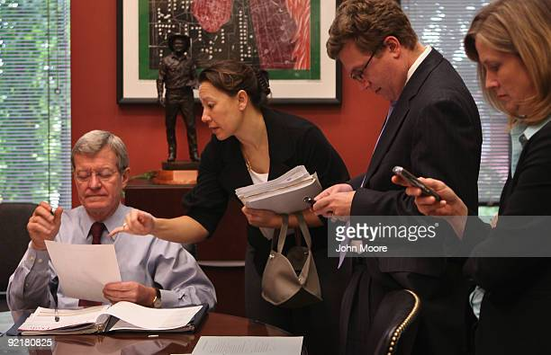 Senior advisors brief Senate Finance Chairman Max Baucus on health reform details ahead of a meeting with Democratic congressional leaders October 20...