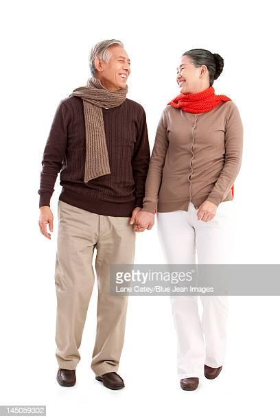 Senior affectionate couple holding hands