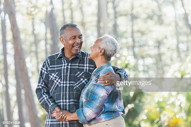 Senior African American couple holding hands in park