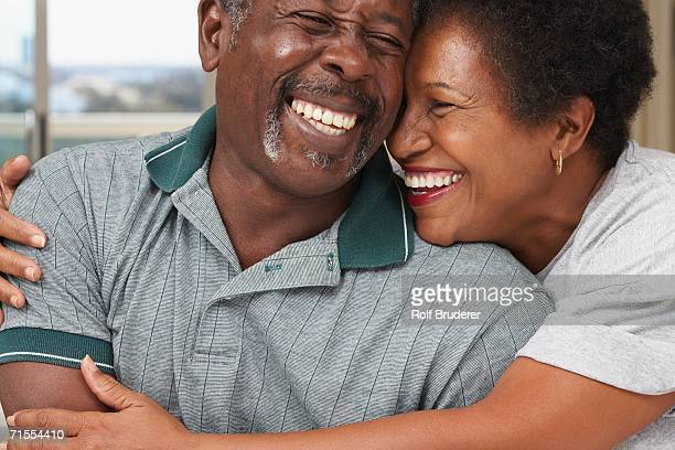 Senior African American couple hugging