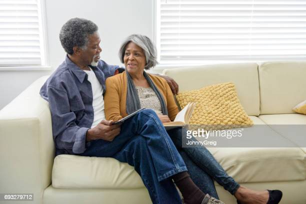 Senior African American couple on sofa at home