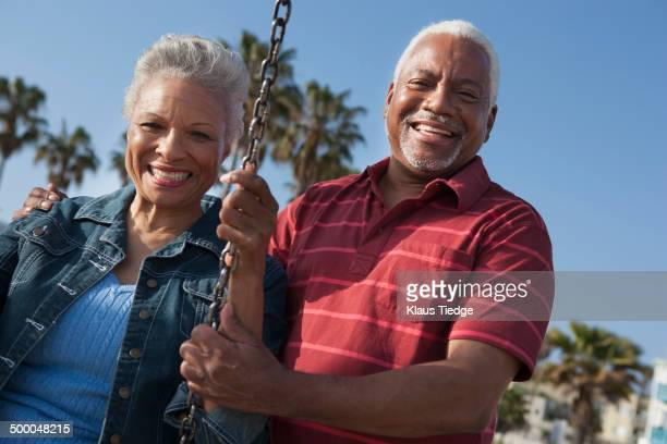 senior african american couple on swing set - casal heterossexual - fotografias e filmes do acervo