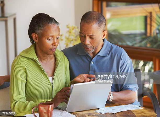 senior african american couple paying bills - identity theft stock pictures, royalty-free photos & images
