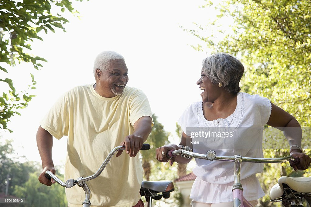 Senior African American couple riding bicycles : Stock Photo
