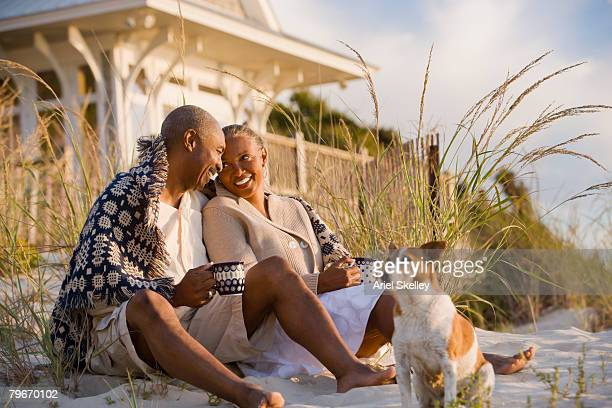 senior african american couple sitting on beach - anniversary stock pictures, royalty-free photos & images