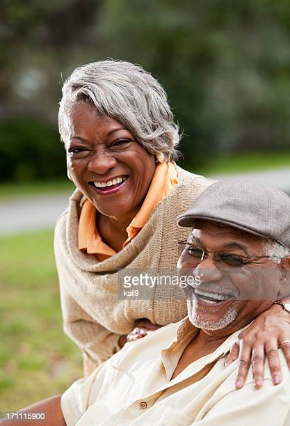 Senior African American couple smiling outdoors