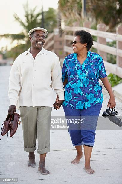 Senior African American couple walking on boardwalk