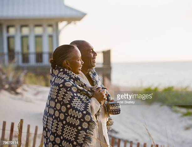 Senior African American couple wrapped in blanket