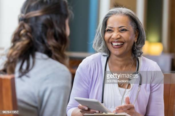 Senior African American female medical school professor with student