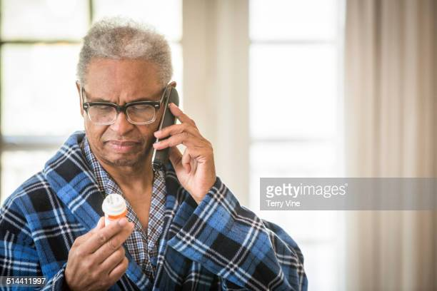 Senior African American man calling doctor about prescription