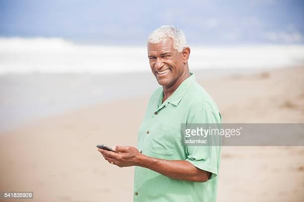 Senior African American Man Checking Smartphone