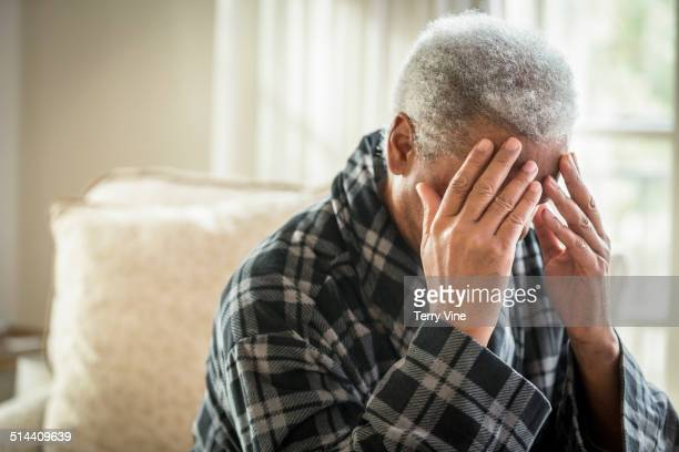 senior african american man covering his face - vulnerability stock pictures, royalty-free photos & images