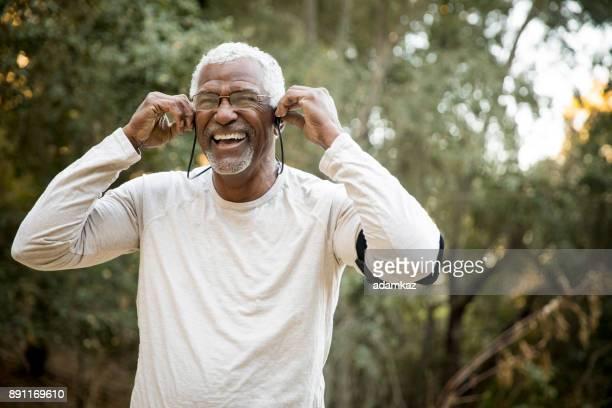 Senior African American Man Headphones Music