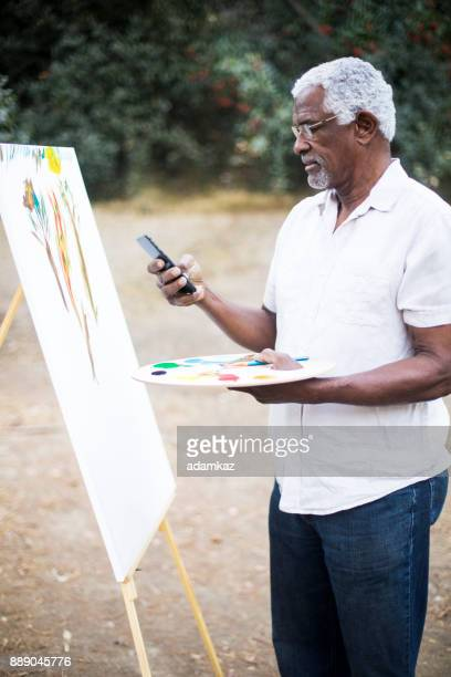 Senior African American Man Painting