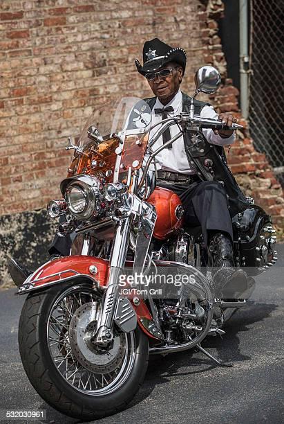 Senior African American man riding motorcycle
