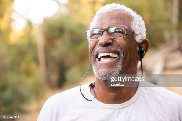 senior african american man smiling during workout - white hair stock photos and pictures