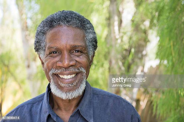 senior african american man smiling towards camera - most handsome black men stock photos and pictures