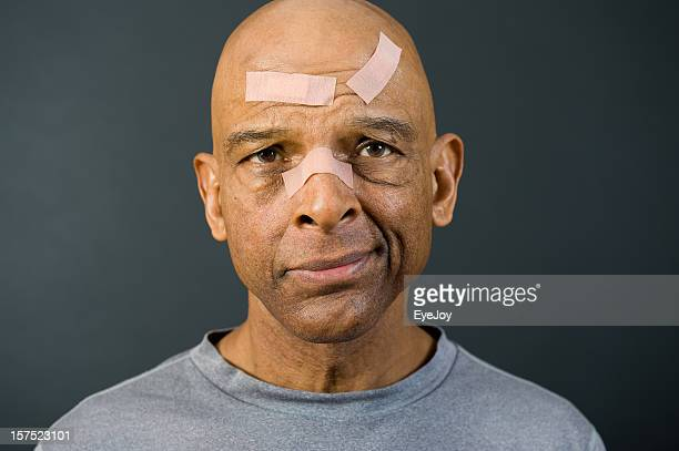 senior african american with bandaged face - head injury stock photos and pictures