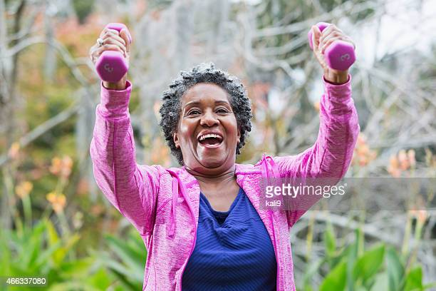 senior african american woman exercising - hand weight stock pictures, royalty-free photos & images