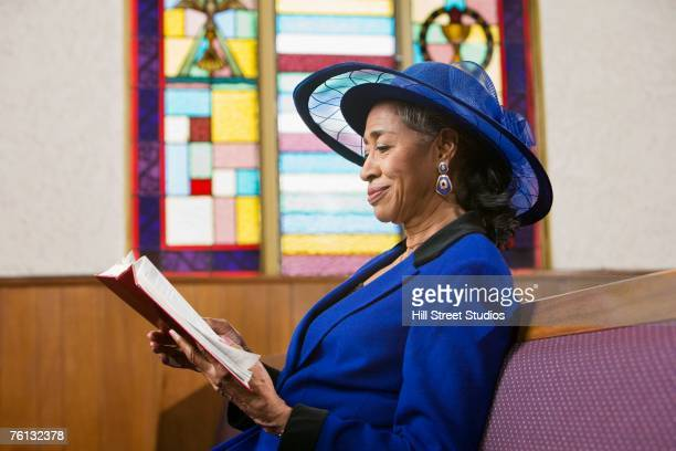 senior african american woman in church - attending stock pictures, royalty-free photos & images