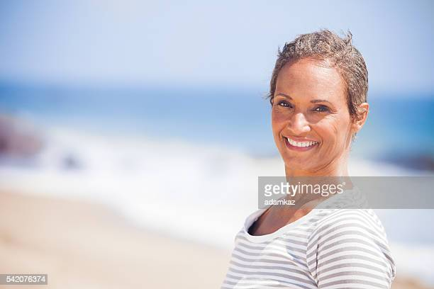 Senior African American Woman Smiling on Beach
