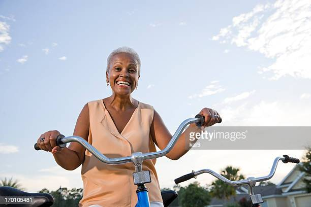 Senior African American woman with bicycle