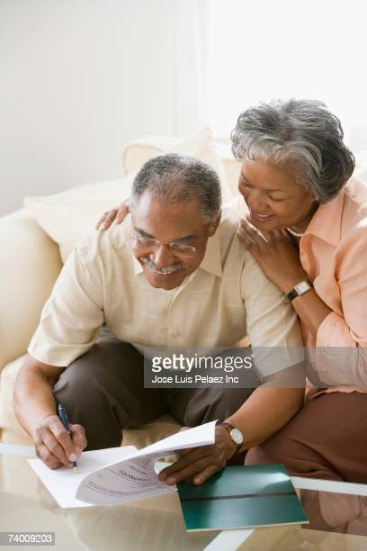 Senior African couple filling out paperwork